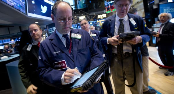 Traders work on the floor of the New York Stock Exchange (N