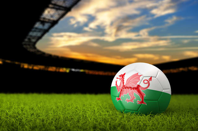 Soccer Background with Ball and Wales Flag