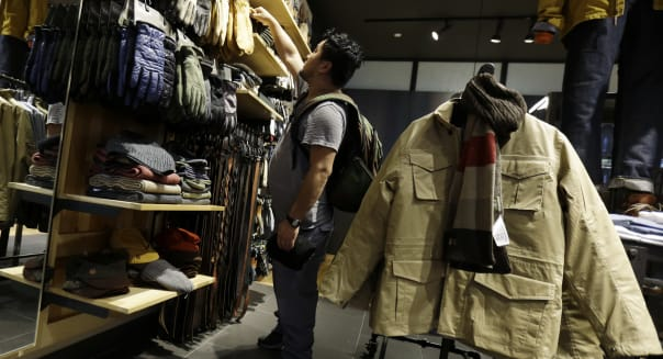 Consumer Confidence (In this Friday, Oct. 4, 2013, photo, a shopper browses at a Timberland store in Skokie, Ill. The Conference
