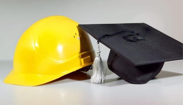 Workers helmet ( worker ) and bachelor berett ( academic ).