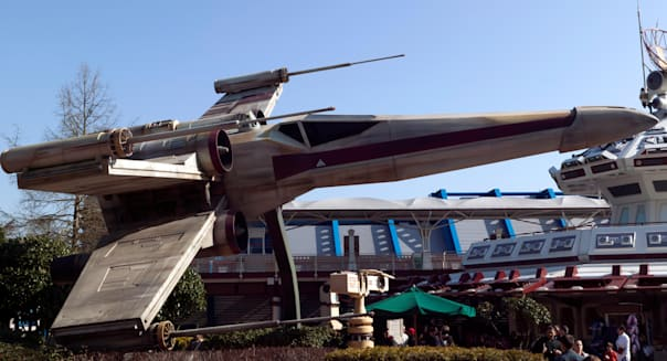 Model of an X-wing starfighter outside the Star Tours ride at Eurodisney.