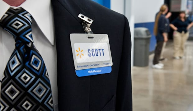 BTEW3E Anglo male shift manager at Walmart is ready to greet customers at grand opening of new store in Austin, Texas, USA.  ret