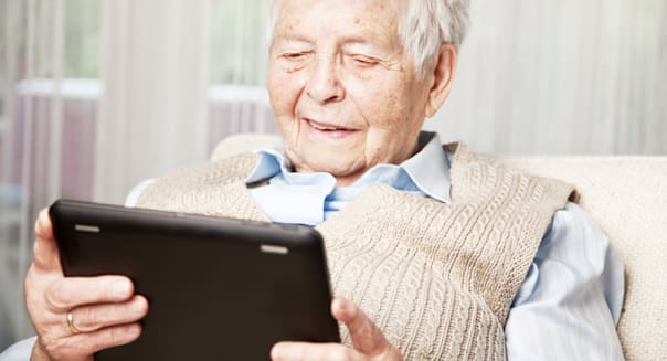 senior woman and digital tablet
