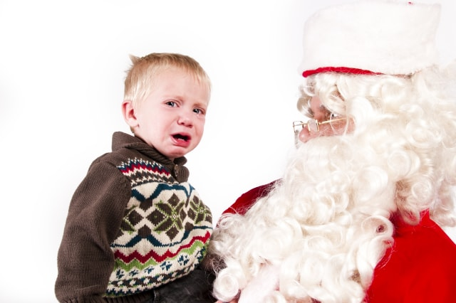 distraught little boy with santa