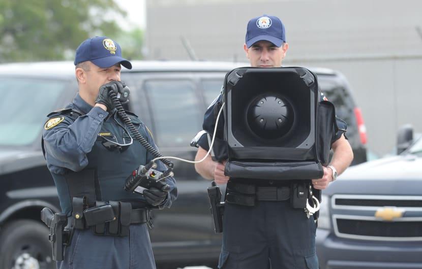 June 3, 2010 Police demonstrate the Long Range Acoustic Device (LRAD). Insp. Gary Meissner, left, an