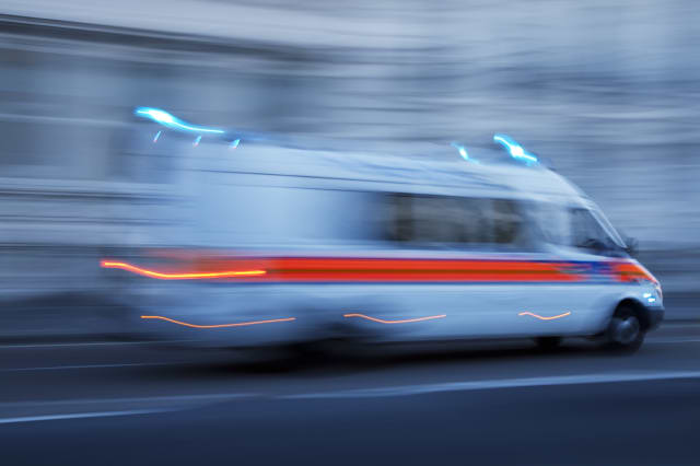 Police Car or Ambulance Speeding, Blurred Motion