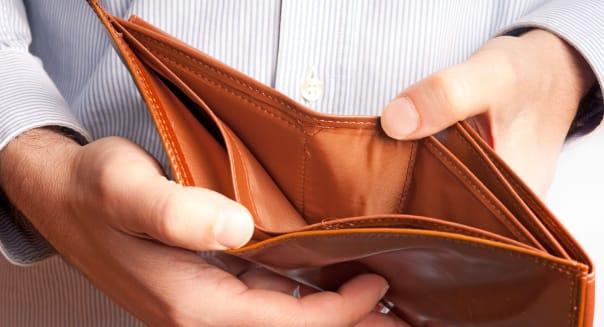 man showing an empty wallet
