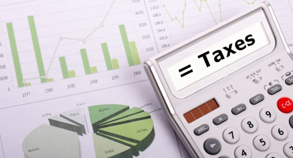 tax or taxes concept with...