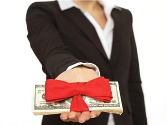 businessperson giving generous...