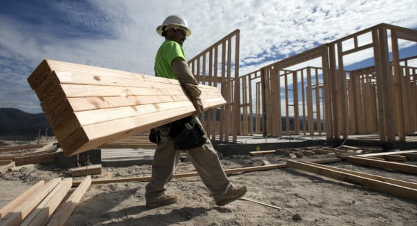 Builder Sentiment (In this Friday, Nov. 16, 2012, photo, construction worker Miguel Fonseca carries lumber as he works on a hous