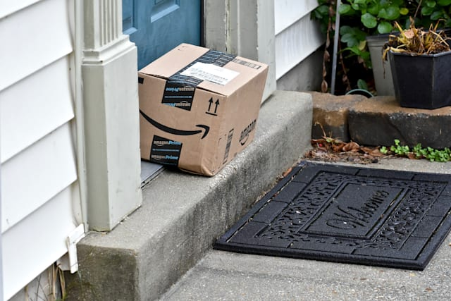 Odenton, United States of America - December 22, 2015: Amazon packages delivered to the front door of a home. Amazon is the larg