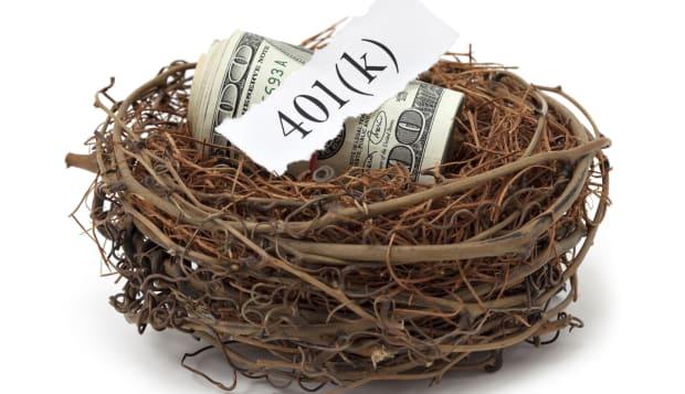 401k retirement savings concept. Roll of money in nest.