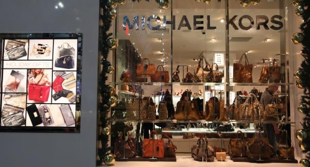 Handbags for sale in Michael Kors store in Toronto Eaton Center, Ontario, Canada