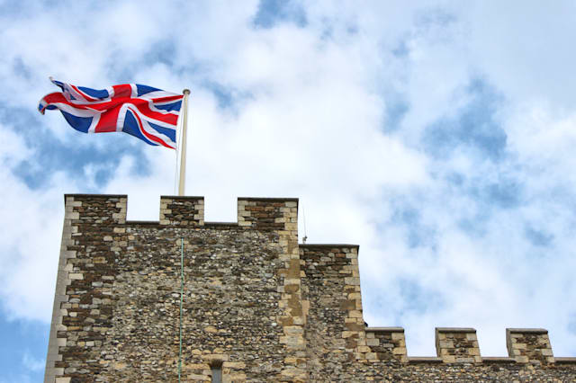 Union flag flying on a castle tower