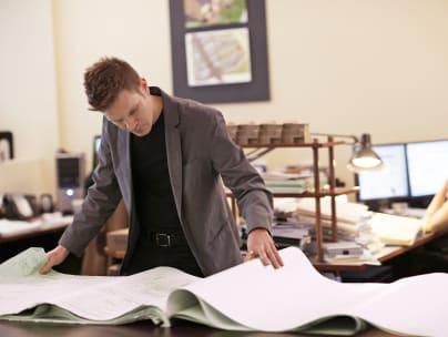 Man checks architectural plans