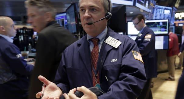 new york stock exchange traders investing market news economy earnings