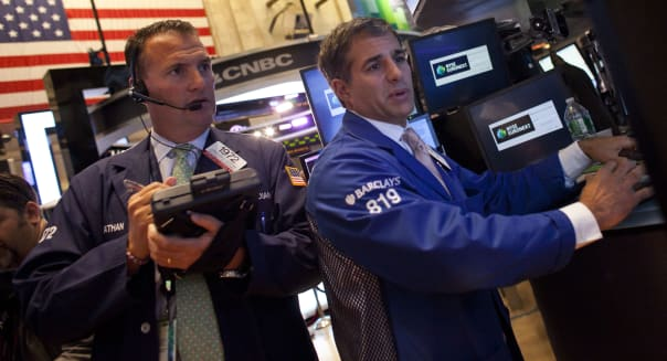 new york stock exchange traders investing wall street earnings