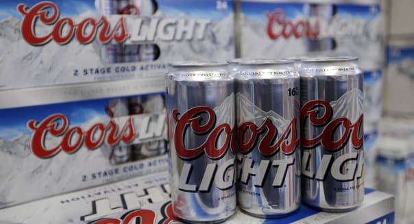 Coors Light Beer is shown on the shelves of the Elite Beverages in Indianapolis, Monday, Jan. 28, 2013.  (AP Photo/Michael Conroy)