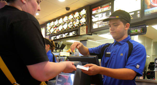 Florida Miami Homestead McDonald's fast food restaurant inside counter employee Hispanic man cashier giving receipt change custo