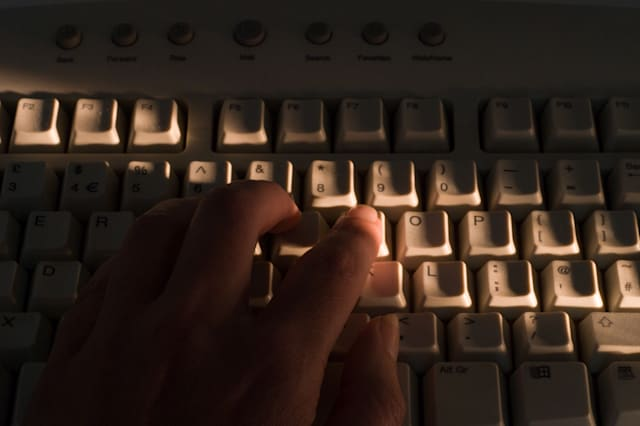 A42KRR Hand on computer keyboard, identity fraud concept. Image shot 2007. Exact date unknown.
