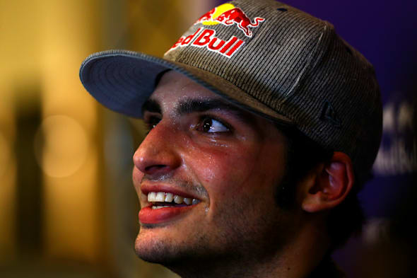 ABU DHABI, UNITED ARAB EMIRATES - NOVEMBER 25:  Carlos Sainz Jr. of Spain and Infiniti Red Bull Racing speaks with members of the media after day one of Formula One testing at Yas Marina Circuit on November 25, 2014 in Abu Dhabi, United Arab Emirates.  (Photo by Dan Istitene/Getty Images) *** Local Caption *** Carlos Sainz Jr.