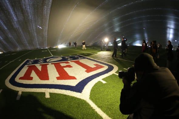 Super Bowl Turf Duspute Football