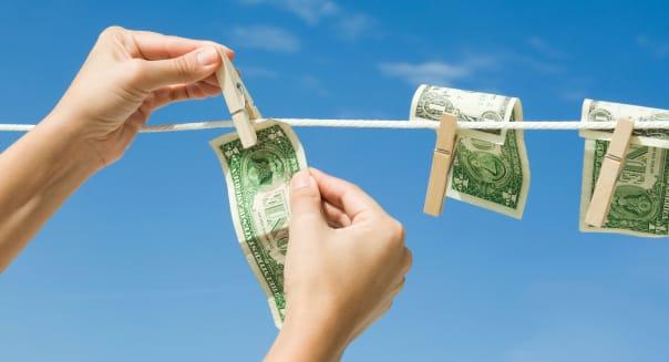 Hanging dollar bills on clothes-line