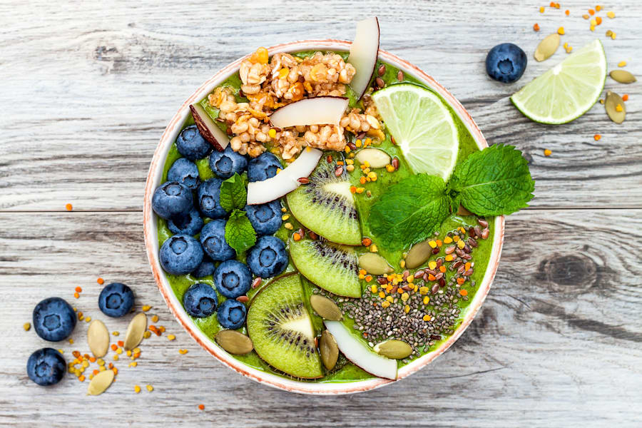 Matcha green tea breakfast superfoods smoothies bowl with chia seeds