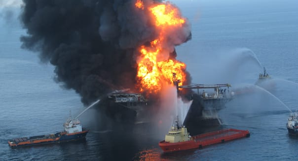 Fire boats battle an explosion at the off shore oil rig Deepwater Horizon