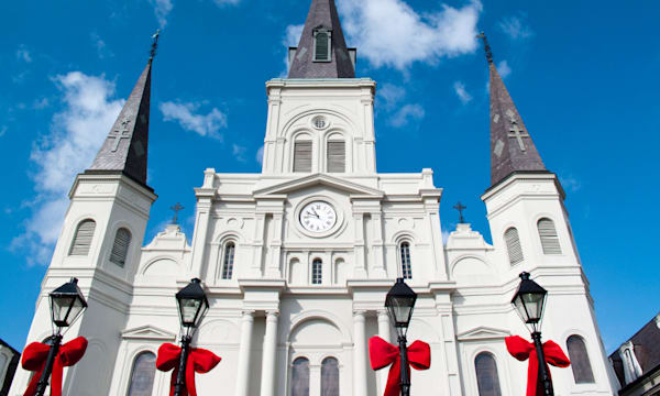 Christmas bows on lamps in Jackson Square, Saint Louis Cathedral; New Orleans, Louisiana, United States