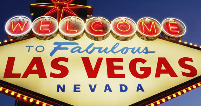 Neon 'Welcome to Las Vegas' 0sign at dusk, low angle view