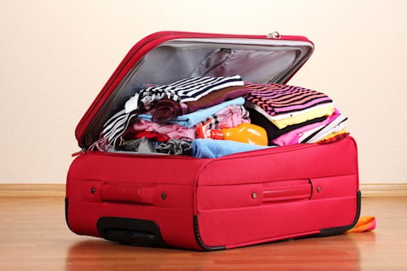 open red suitcase with clothing ...