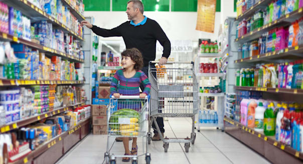 Man and child shopping at supermarket