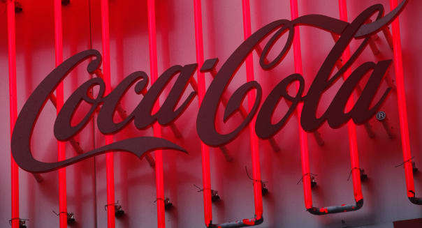EARNS COCA COLA (In this July 11, 2013 photo, a neon sign for Coca Cola is illuminated in New York. (AP Photo/Mark Lennihan))