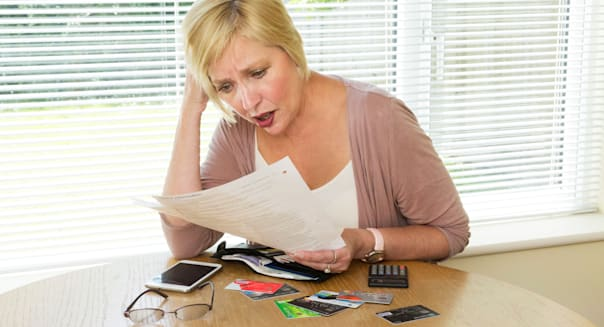 woman shocked at reading her credit card bill