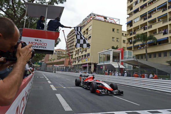 Jules Bianchi (FRA) Marussia F1 Team MR03 takes the chequered flag at the end of the race to score the team's first F1 points.25.05.2014. Formula 1 World Championship, Rd 6, Monaco Grand Prix, Monte Carlo, Monaco, Race Day.