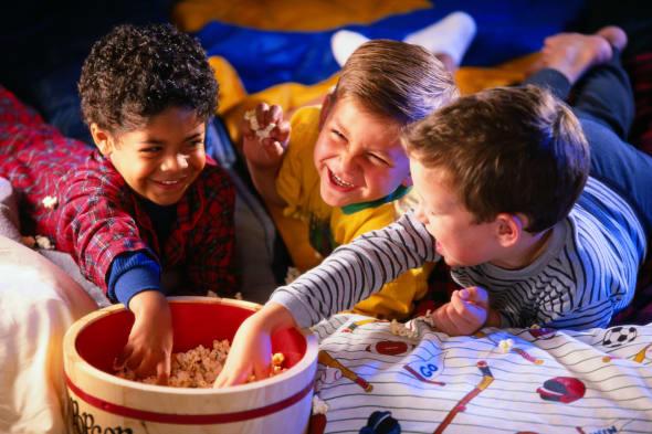 Boys Eating Popcorn at Slumber Party