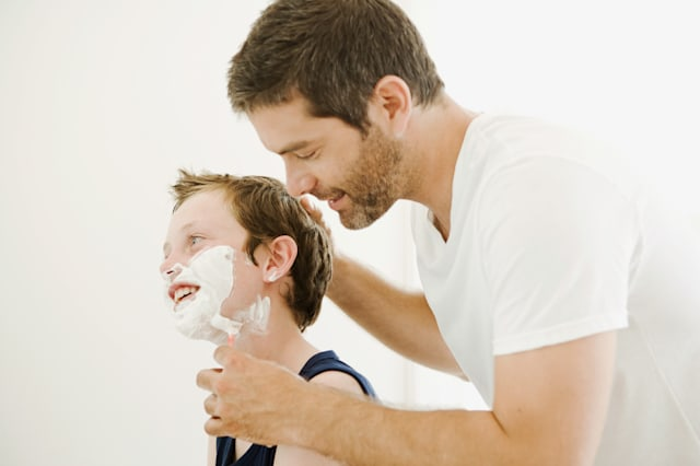 teaching how to shave.
