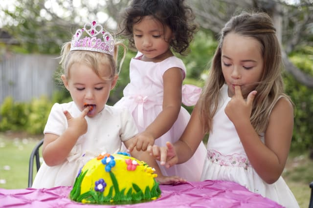 three cute little girls with cake