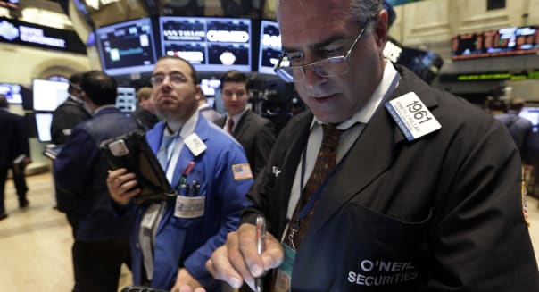 Trader Kenneth Polcari, right, works on the floor of the New York Stock Exchange Tuesday, Oct. 15, 2013.The stock market edged lower early Tuesday even though Republican and Democratic leaders in the Senate reported that a deal over the nation's borrowing limit appears to be getting closer. (AP Photo/Richard Drew)