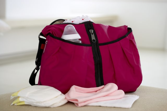 Bag with pockets holding baby supplies