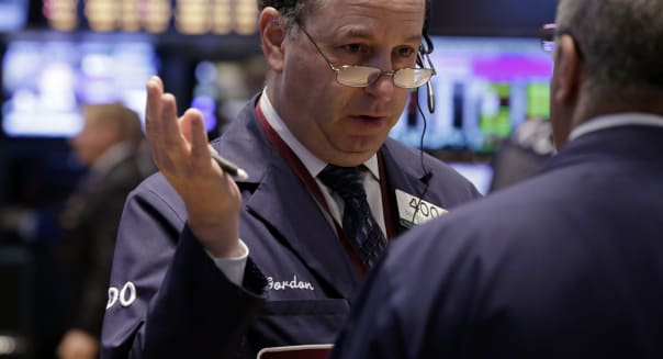 Wall Street (Gordon Charlop, left, confers with a fellow trader on the floor of the New York Stock Exchange Wednesday, Oct. 9, 2