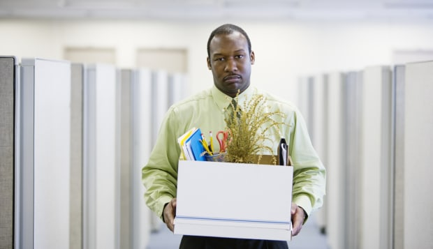 Office worker carrying box, portrait