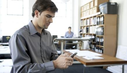 Office worker using blackberry