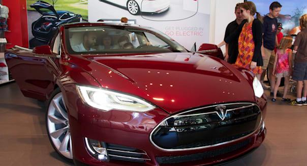 17, June, 2012, Oak Brook, Illinois, USA. Prospective customers consider the new Tesla Motors Model S. The Model S, an all elect