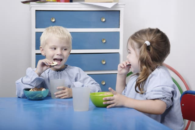Children eating snacks in playgroup