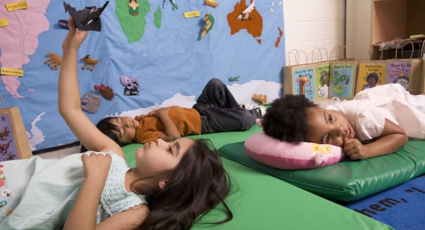 Children (2-5) relaxing in classroom