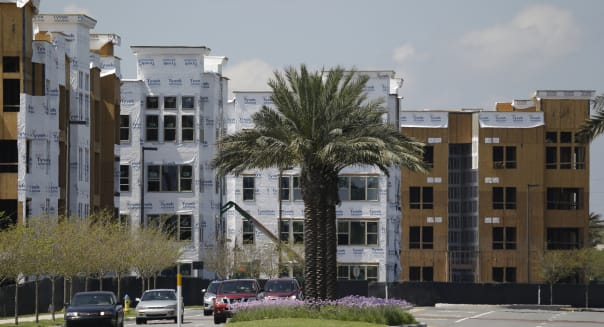 FILE - In this Wednesday, March 25, 2015, file photo, apartment buildings under construction are seen, in Maitland, Fla., a suburb of Orlando. The Commerce Department reports on October U.S. home construction Wednesday, Nov. 18, 2015. (AP Photo/John Raoux, File)