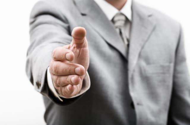 businessman offering hand
