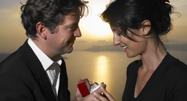 Man proposing to woman, sunset